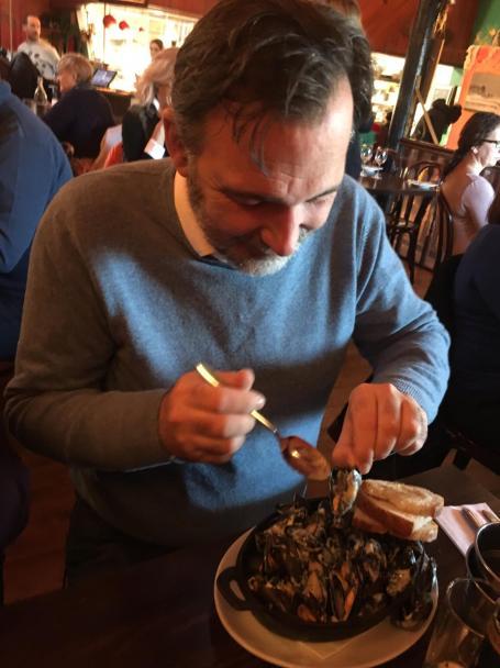 CFO, Mr. Jonathan Mills shucking some oysters.